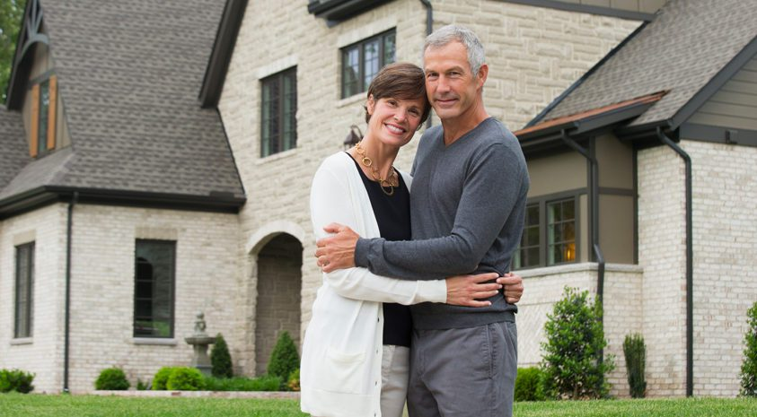 couple-downsizing-large-home-before-retirement